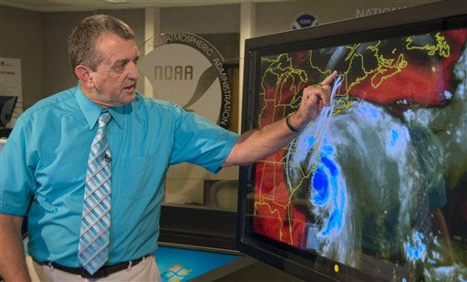 National Hurricane Center Director Bill Read uses a Telestrator to visually illustrate the impact of Hurricane Irene on the North Carolina coast during a live television interview Saturday, Aug. 27, 2011, at the hurricane center in Miami.  <span class=meta>(AP Photo&#47; Andy Newman)</span>