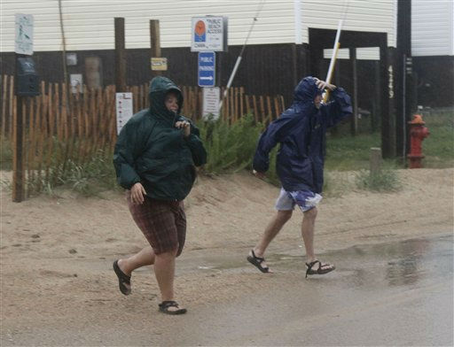 People run from the beach in Kitty Hawk, Outer Banks, N.C., Saturday, Aug. 27, 2011, as Hurricane Irene reaches the North Carolina coast. <span class=meta>(AP Photo&#47; Charles Dharapak)</span>