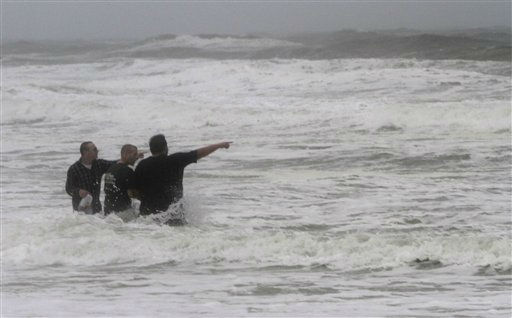 Virginia Beach visitors point out the waves as Hurricane Irene approaches the region in Virginia Beach, Va., Saturday, Aug. 27, 2011.  <span class=meta>(AP Photo&#47; Steve Helber)</span>
