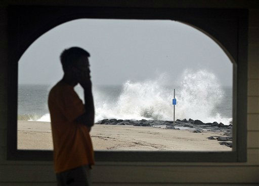A person looks out from a shelter early Saturday, Aug. 27, 2011, in Cape May, N.J. , while waves pound a jetty in stormy weather, as Hurricane Irene approaches.  <span class=meta>(AP Photo&#47; Mel Evans)</span>