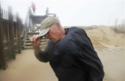 Summer resident Jody Bowers braces himself from a blast of sand and driving rain as he makes his way to the beach in Kill Devil Hills, Outer Banks, N.C., Saturday, Aug. 27, 2011. <span class=meta>(AP Photo&#47; Charles Dharapak)</span>