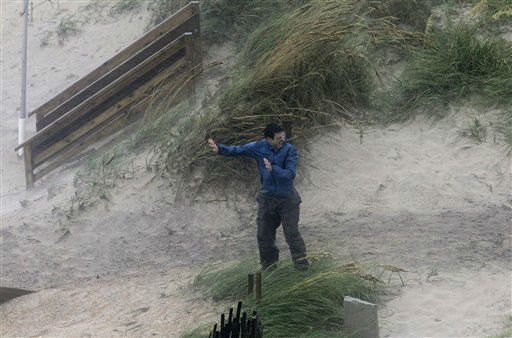 A man struggles against the wind while trying to walk over the dunes as the effects of Hurricane Irene are felt in Nags Head, N.C., Saturday, Aug. 27, 2011   <span class=meta>(AP Photo&#47; Gerry Broome)</span>