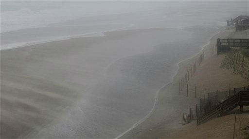 "<div class=""meta ""><span class=""caption-text "">Wind and water whip across the beach as the effects of Hurricane Irene are felt in Nags Head, N.C., Saturday, Aug. 27, 2011   (AP Photo/ Gerry Broome)</span></div>"