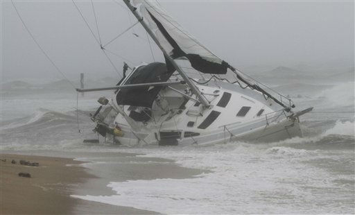 A stranded sailboat founders in the surf along the Willoughby Spit area of Norfolk, Va. as Hurricane Irene hits Norfolk, Va., Saturday, Aug. 27, 2011.  <span class=meta>(AP Photo&#47; Steve Helber)</span>