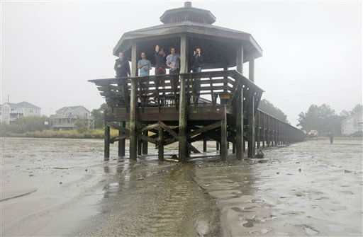 Residents stand on a pier after Hurricane Irene pulled all the water away and into the Albemarle Sound on the Outer Banks in Kill Devil Hills, N.C., Saturday, Aug. 27, 2011  <span class=meta>(AP Photo&#47; Charles Dharapak)</span>