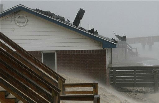 "<div class=""meta ""><span class=""caption-text "">Shingles are torn from rooftops as the effects of Hurricane Irene are felt in Nags Head, N.C. on Saturday, Aug. 27, 2011. (AP Photo/ Gerry Broome)</span></div>"