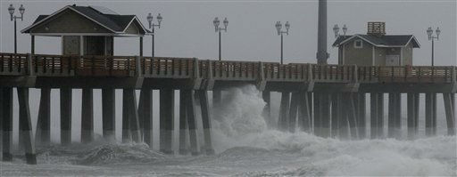 Waves crash under Jeannette&#39;s Pier as the effects of Hurricane Irene are felt in Nags Head, N.C., Saturday, Aug. 27, 2011.  <span class=meta>(AP Photo&#47; Gerry Broome)</span>