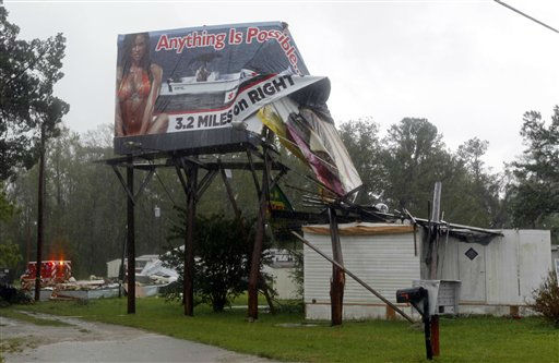"<div class=""meta ""><span class=""caption-text "">An outdoor advertising sign and several mobile homes were damaged by winds in New Bern, N.C. on Saturday, Aug. 27, 2011 as Hurricane Irene hits the North Carolina coast.  (AP Photo/ Chuck Burton)</span></div>"