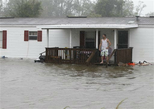 Jarod Wilton looks at the flood waters rising to his doorstep, Saturday, Aug. 27, 2011, in Alliance, N.C. <span class=meta>(AP Photo&#47; Chuck Burton)</span>