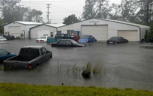 Vehicles sit in flood waters at a auto repair shop, N.C., Saturday, Aug. 27, 2011  <span class=meta>(AP Photo&#47; Chuck Burton)</span>