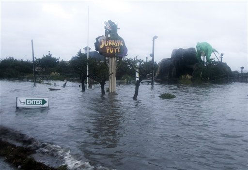 "<div class=""meta ""><span class=""caption-text "">Floodwaters from the Albemarle Sound rise over a mini golf course at dusk on the Outer Banks in Nags Head, N.C., Saturday, Aug. 27, 2011  (AP Photo/ Charles Dharapak)</span></div>"