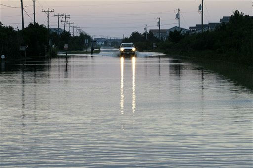 A vehicle navigates through water in the road left behind by Hurricane Irene in Nags Head, N.C., Sunday, Aug. 28, 2011.  <span class=meta>(AP Photo&#47; Gerry Broome)</span>