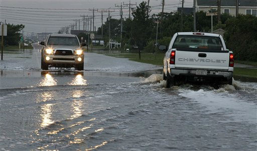 Cars navigate standing water in the road left behind by Hurricane Irene in Nags Head, N.C., Sunday, Aug. 28, 2011.  <span class=meta>(AP Photo&#47; Gerry Broome)</span>