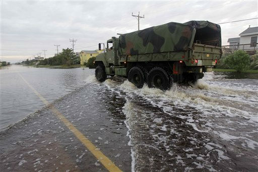 A truck plows through standing water in the road left behind by Hurricane Irene in Nags Head, N.C., Sunday, Aug. 28, 2011.  <span class=meta>(AP Photo&#47; Gerry Broome)</span>