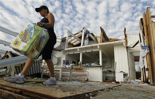 "<div class=""meta ""><span class=""caption-text "">Denise Robinson clears out her destroyed beach home in the Sandbridge area of Virginia Beach after Hurricane Irene hit Virginia Beach, Va., Sunday, Aug. 28, 2011.   (AP Photo/ Steve Helber)</span></div>"