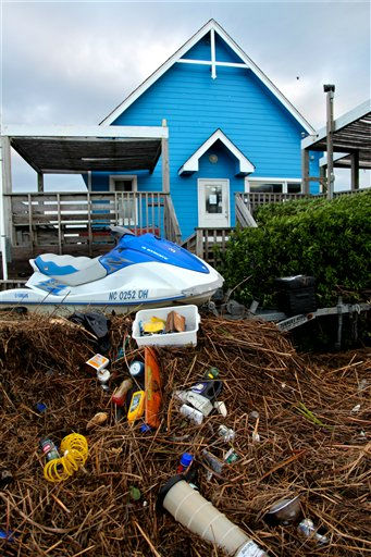"<div class=""meta ""><span class=""caption-text "">Debris from Hurricane Irene piles up on Whalebone Sound near Nags Head, N.C., Sunday, Aug. 28, 2011. (AP Photo/ Robert Ray)</span></div>"
