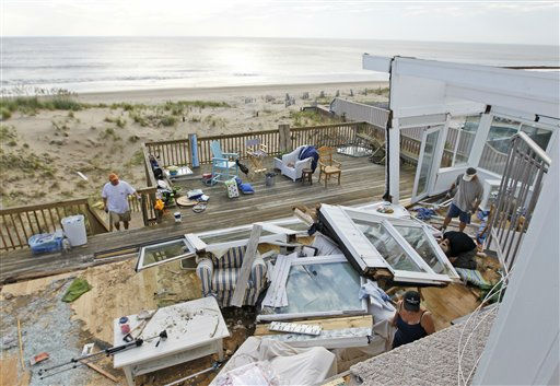 "<div class=""meta ""><span class=""caption-text "">Casey and Denise Robinson clear out their destroyed beach home in the Sandbridge area of Virginia Beach, Va., Sunday, Aug. 28, 2011 (AP Photo/ Steve Helber)</span></div>"