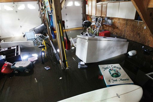 A refrigerator and other items float in Lechelle Spalding&#39;s flooded garage after a storm surge on the Outer Banks in Kitty Hawk, N.C., Sunday, Aug. 28, 2011  <span class=meta>(AP Photo&#47; Charles Dharapak)</span>