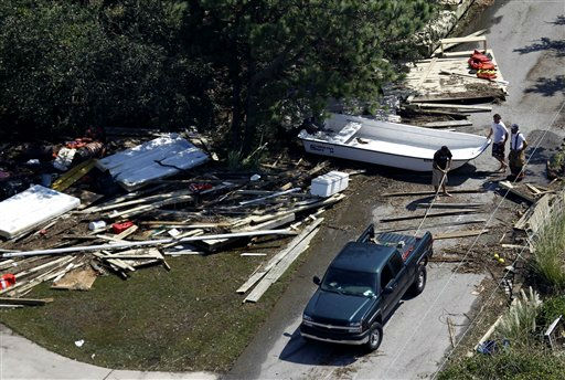 Residents work to remove a boat from the roadway in Duck, N.C., Sunday, Aug. 28, 2011. <span class=meta>(AP Photo&#47; Steve Helber)</span>