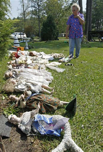 "<div class=""meta ""><span class=""caption-text "">Mavis Powers looks over the items salvaged from her home in South Creek, N.C., Sunday, Aug. 28, 2011. (AP Photo/ Chuck Burton)</span></div>"