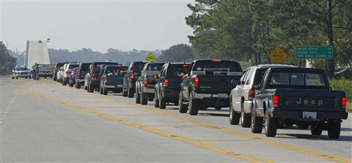 "<div class=""meta ""><span class=""caption-text "">Residents line up to enter Emerald Isle, N.C., Sunday, Aug. 28, 2011 after Hurricane Irene hit the North Carolina coast.  (AP Photo/ Chuck Burton)</span></div>"