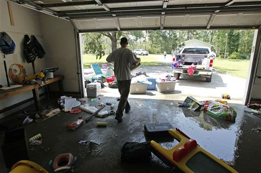 "<div class=""meta ""><span class=""caption-text "">Brad Potter removes items from his flooded home in South Creek, N.C., Sunday, Aug. 28, 2011. (AP Photo/ Chuck Burton)</span></div>"