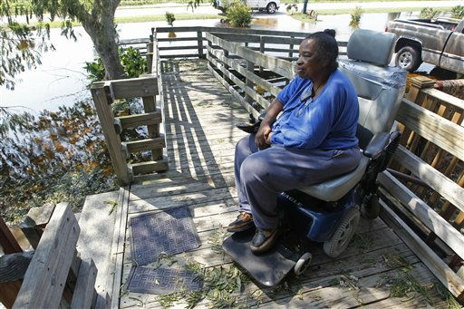 "<div class=""meta ""><span class=""caption-text "">Barbara Moore looks at the flood waters surrounding her home as she sits in her wheelchair in Aurora, N.C., Sunday, Aug. 28, 2011. (AP Photo/ Chuck Burton)</span></div>"