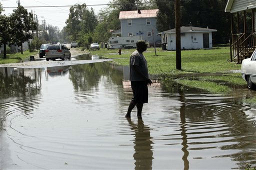 Ernest Trip walks in flood waters in front of his home during the aftermath of Hurricane Irene, Sunday, Aug. 28, 2011 in New Bern, N.C. <span class=meta>(AP Photo&#47; Jim R. Bounds)</span>