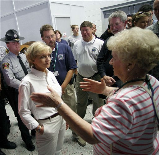 North Carolina Governor Bev Perdue, left, listens to Sondna Ipock-Riggs about the damage Hurricane Irene left behind, Sunday, Aug. 28, 2011 in Trenton, N.C.  <span class=meta>(AP Photo&#47; Jim R. Bounds)</span>