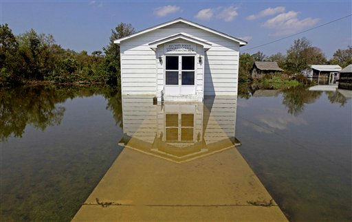 "<div class=""meta ""><span class=""caption-text "">The Stumpy Point Congregational Holiness Church is shown surrounded by water following the effects of Hurricane Irene in Stumpy Point, N.C., Sunday, Aug. 28, 2011. (AP Photo/ Gerry Broome)</span></div>"