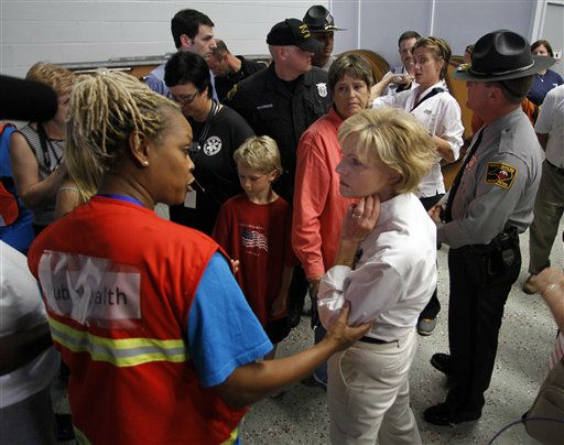 North Carolina Governor Bev Perdue, right, speaks with an Red Cross worker about damage Hurricane Irene left behind in Trenton, N.C., Sunday, Aug. 28, 2011.  <span class=meta>(AP Photo&#47; Jim R. Bounds)</span>