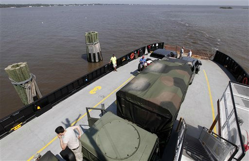 Members of the North Carolina National Guard load onto a ferry in Stumpy Point, N.C., Sunday, Aug. 28, 2011 to deliver supplies to people on Hatteras Island  following the effects of Hurricane Irene. The storm damaged the main road on the barrier island cutting off residents from the mainland.  <span class=meta>(AP Photo&#47; Gerry Broome)</span>