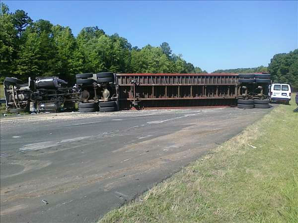 One of the trucks rests on its side after the accident. <span class=meta>(WTVD Photo&#47; Image courtesy Mark Willhoit)</span>