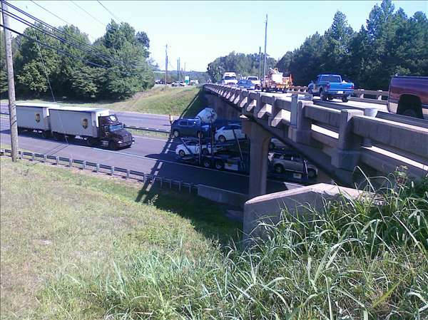 "<div class=""meta image-caption""><div class=""origin-logo origin-image ""><span></span></div><span class=""caption-text"">One of the cement truck mixing cylinders lies under a bridge. (WTVD Photo/ Image courtesy Mark Willhoit)</span></div>"