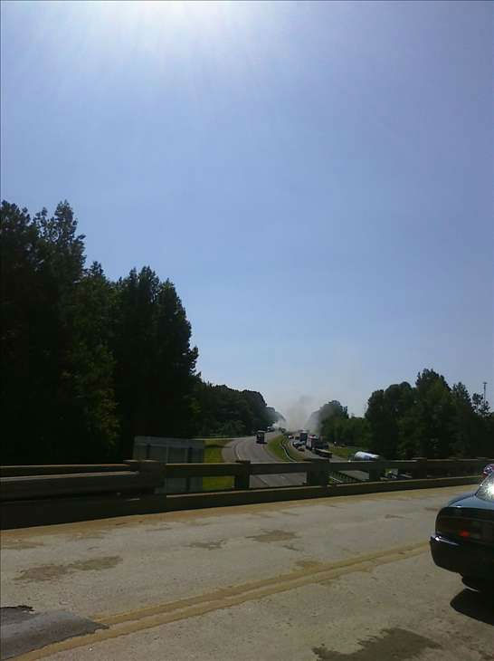 "<div class=""meta image-caption""><div class=""origin-logo origin-image ""><span></span></div><span class=""caption-text"">Smoke visible from an I-85 overpass. (WTVD Photo/ Image courtesy Mark Willhoit)</span></div>"