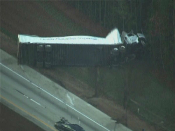 "<div class=""meta image-caption""><div class=""origin-logo origin-image ""><span></span></div><span class=""caption-text"">A crash involving a semi on I-40 east near White Oak Rd. in Garner slowed the morning commute Friday. (WTVD Photo/ Chopper 11 HD)</span></div>"
