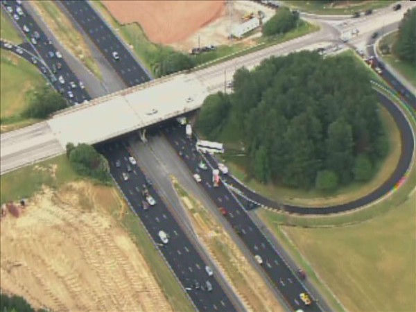 One person was killed when a tour bus crashed along I-40 in Raleigh Monday afternoon. <span class=meta>(WTVD Photo&#47; Chopper 11 HD)</span>