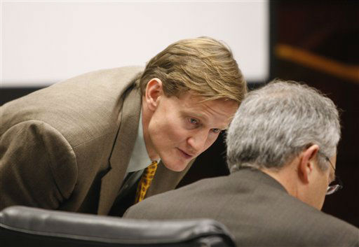 Jason Young speaks with his lawyer, Wake County public defender Bryan Collins, during his retrial in Raleigh, N.C., on Tuesday, Feb. 7, 2012. <span class=meta>(AP Photo&#47; Shawn Rocco)</span>
