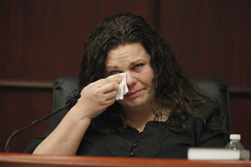 Meredith Fisher, sister of Michelle Young, tears up as she describes her sister&#39;s relationship with Jason Young during his retrial on Tuesday, Feb. 7, 2012 in Raleigh, N.C.  <span class=meta>(AP Photo&#47; Shawn Rocco)</span>