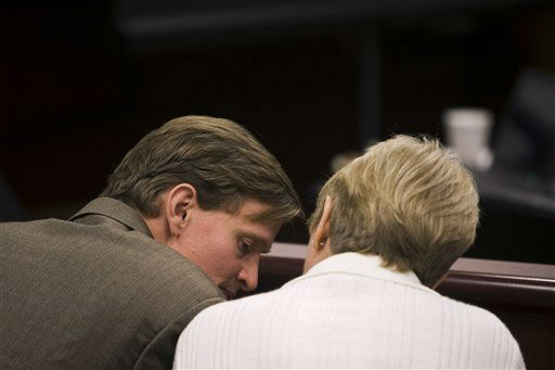 Jason Young speaks with mother Pat Young during a recess in his retrial Tuesday, Feb. 7, 2012 in Raleigh, N.C.  <span class=meta>(AP Photo&#47; Shawn Rocco)</span>