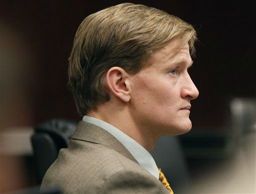 Jason Young listens as Meredith Fisher, sister of Michelle Young, describes Michelle&#39;s relationship with him during his retrial on Tuesday, Feb. 7, 2012 in Raleigh, N.C. <span class=meta>(AP Photo&#47; Shawn Rocco)</span>