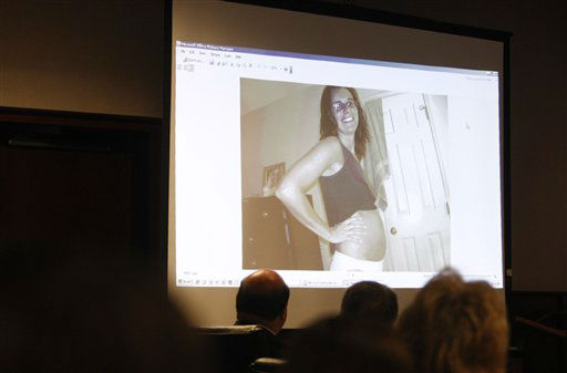 A photo of a pregnant Michelle Young is displayed for the jury during Jason Young&#39;s retrial on Tuesday, Feb. 7, 2012 in Raleigh, N.C.  <span class=meta>(AP Photo&#47; Shawn Rocco)</span>