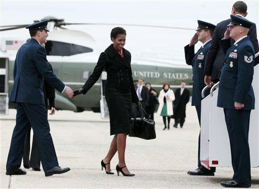 "<div class=""meta ""><span class=""caption-text "">President Barack Obama and first lady Michelle Obama walk toward Air Force One, Wednesday, Dec. 14, 2011, at Andrews Air Force Base, Md., en route to Fort Bragg, N.C.  (AP Photo/ Carolyn Kaster)</span></div>"
