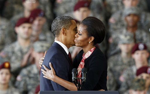 President Barack Obama and first lady Michelle Obama embrace during their visit to Fort Bragg, N.C., Wednesday, Dec. 14, 2011.  <span class=meta>(AP Photo&#47; Gerry Broome)</span>