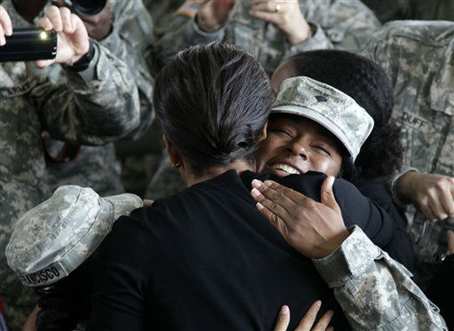 First lady Michelle Obama hugs a woman in the military  in the 440th Structural Maintenance Hangar at Fort Bragg, N.C., Wednesday, Dec. 14, 2011. <span class=meta>(AP Photo&#47; Carolyn Kaster)</span>