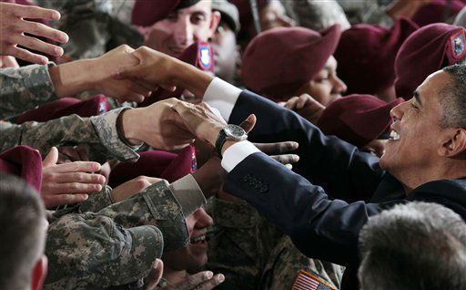 President Barack Obama greets members of the military at the 440th Structural Maintenance Hangar at Fort Bragg, N.C., Wednesday, Dec. 14, 2011.  <span class=meta>(AP Photo&#47; Carolyn Kaster)</span>