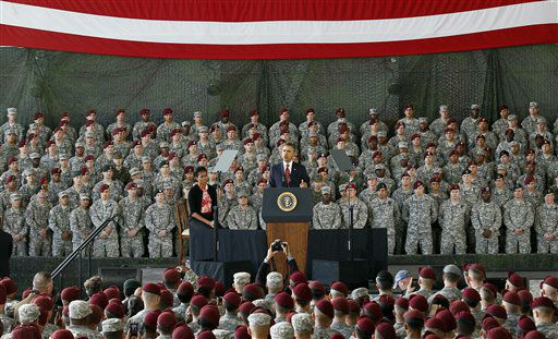 "<div class=""meta ""><span class=""caption-text "">President Barack Obama, accompanied by first lady Michelle Obama, speaks to troops at Fort Bragg, N.C., Wednesday, Dec. 14, 2011.  (AP Photo/ Gerry Broome)</span></div>"