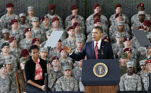 President Barack Obama, accompanied by first lady Michelle Obama, speaks to troops at Fort Bragg, N.C., Wednesday, Dec. 14, 2011.  <span class=meta>(AP Photo&#47; Gerry Broome)</span>