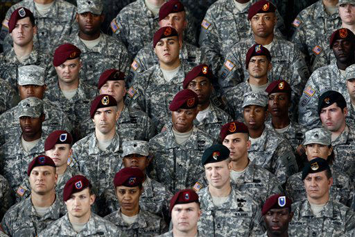 "<div class=""meta ""><span class=""caption-text "">Troops listen as President Barack Obama speaks during a visit to Fort Bragg, N.C., Wednesday, Dec. 14, 2011.  (AP Photo/ Gerry Broome)</span></div>"