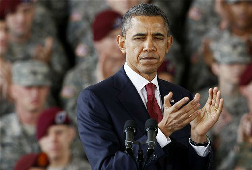 President Barack Obama applauds the troops during a visit to Fort Bragg, N.C., Wednesday, Dec. 14, 2011.  <span class=meta>(AP Photo&#47; Gerry Broome)</span>